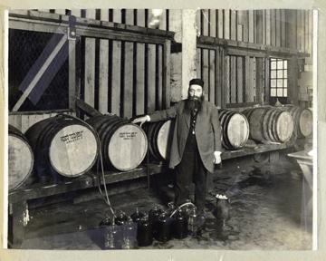 Rabbi Mayer Hirsch with barrels of sacramental kosher wine during Prohibition