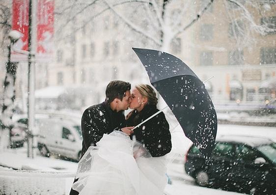 Winter wedding kiss