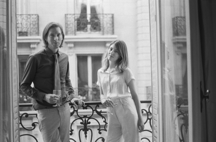 Wes Anderson and Sofia Coppola drinking wine on balcony
